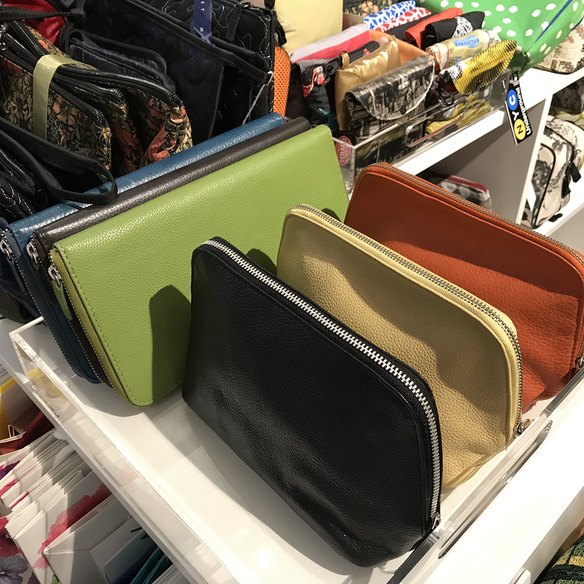 Samples of custom color leather cosmetic bags in the Gouda showroom