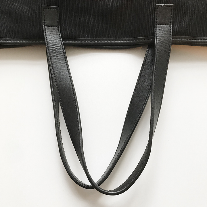 Black sewn leather handles and leather trim
