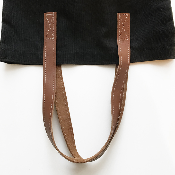 Stitched light brown leather handles